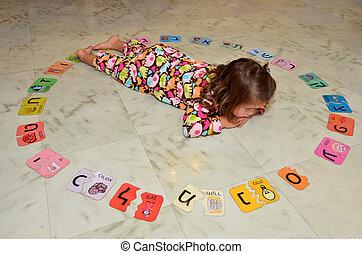 Hebrew alphabet - Little Jewish Israeli girl study the...
