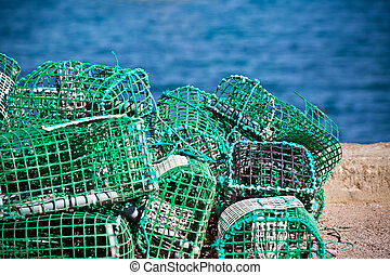 Lobster and Crab traps stack in a port. Horizontal shot