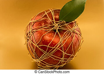 red apple on a gold background
