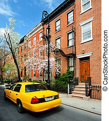 Taxi in the Village - Yellowcab passes by Greenwich Village...