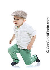 Dapper little boy in a cute outfit with a cloth cap, white...
