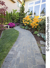 Garden Brick Paver Path Walkway with Green Grass Lawn and...