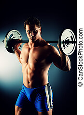 working out - Portrait of a handsome bodybuilder posing over...