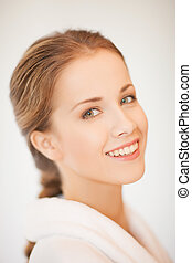 beautiful woman in bathrobe - close up of beautiful woman in...