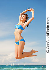 woman in bikini jumping - picture of beautiful woman in...