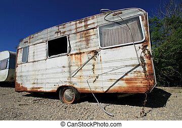 Dusty abandonned old caravan in the nature by beautiful day