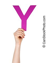 the letter Y, hold by a hand, isolated