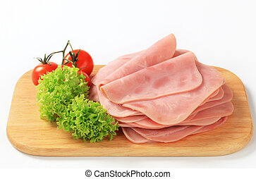 Thinly sliced ham on a cutting board