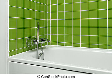 Bathtub with modern faucet in green bathroom
