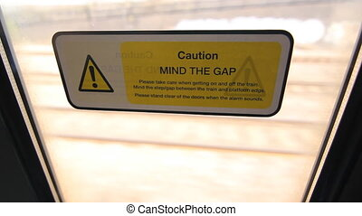 Mind the Gap. - Mind the Gap sticker on train window. East...
