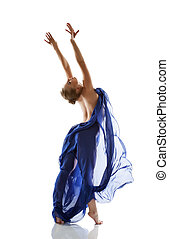 Pretty young blonde dancing with blue cloth in studio