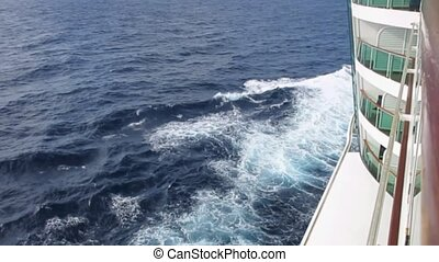 The Cruise - Waves break from a cruise ship at sea