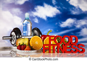 Fitness food - Dumbbells, fresh fruits, vegetables and...