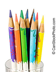 Bunch of color pencils in a glass isolated on white