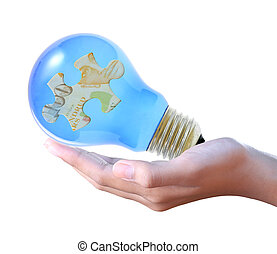 puzzle in bulb on hand
