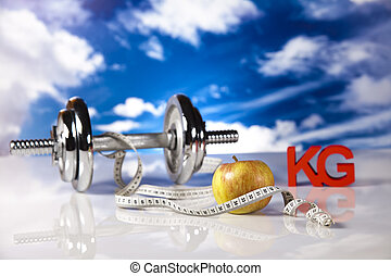 Weight loss, fitnes - Dumbbells, fresh green fruits and...