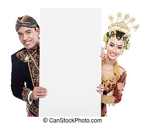 traditional java wedding couple husband and wife holding...