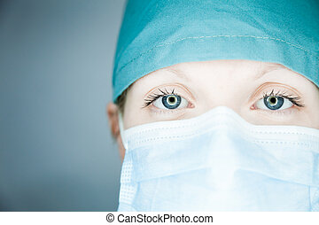 Nurse looking at you close-up - Young nurse in studio on a...