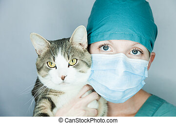 I do care of your animal ! - Young nurse in studio on a gray...