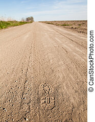 Foot Step in a dusty country road