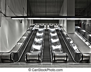 Sets of Working Escalator (wide angle) - There is a long...