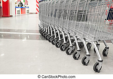 row of empty cart in the supermarket - row of empty big cart...