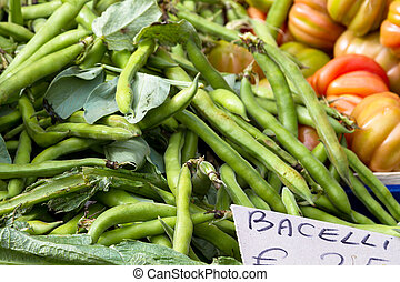 Broad beans for sale at market - Heap of broad beans for...