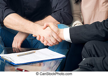 Close-up of two shaking hands - Close-up of a handshake of...