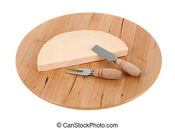 Italian spicy provolone cheese with cheese knife on white...