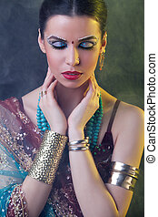 Beauty portrait of a young indian woman in traditional...