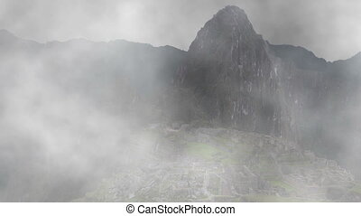 Machu Picchu Appearing from Fog - The ancient Incan city of...