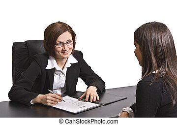 Job interview - Two businesswomen at an interview in an...