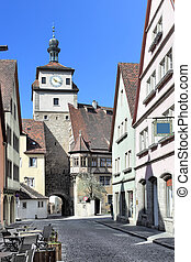 Rothenburg ob der Tauber - Old street and town gate in...