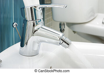 Water faucet - White toilet bidet object in a clean room...