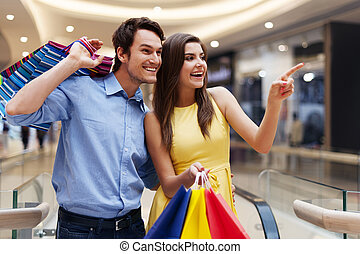 Woman showing something in the shopping mall