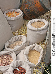 old spice market with selling corn and wheat seeds in jute...