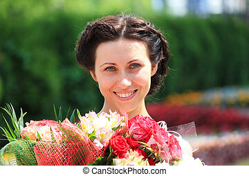 Fashion girl with  bunch of flowers