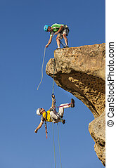 Climbing team struggles to the summit - Climbing team...