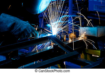 human working of welding with a lot of sparks in a metal...