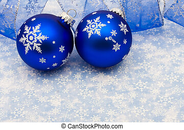 Merry Christmas - Blue glass ball and ribbon on blue...