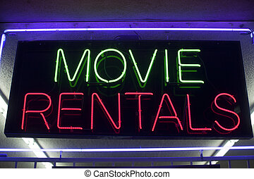 movie rentals neon sign in a store window