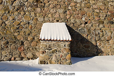 vintage fort stone wall clay tile roof snow winter