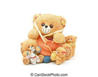 Knitting teddy bear family. Clay figurine isolated on white