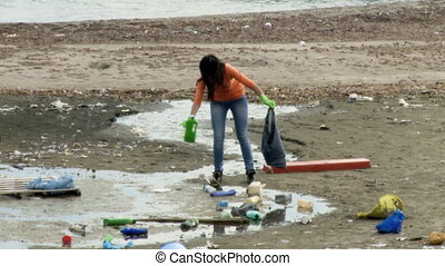 Woman social worker clean dirt - Young beautiful woman...