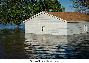 Small building in flood water - Small building is surrounded...