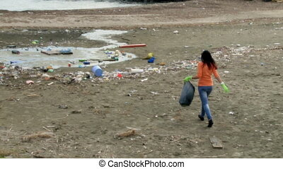 Nature disaster dirt and dump - Young woman cleaning dirty...