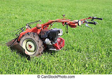 The red lawn mower - Pastorale in Provence, France. Green...