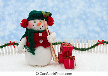 Merry Christmas - Snowman and white picket fence with green...