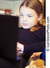 portrait of young little girl with laptop