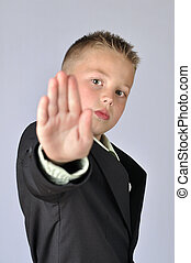 Stop there - Young child in business suit with hand extended...